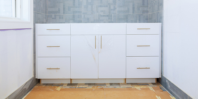 Bathroom vanity cabinets without sink and countertop.