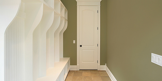White Wooden Cubbies in Entrance Hallway.