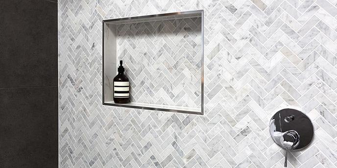 Porcelain Tile in Chevron Pattern on Shower Wall