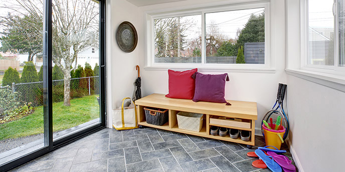 Wooden Storage Bench Near Sliding Glass Door in Mudroom.