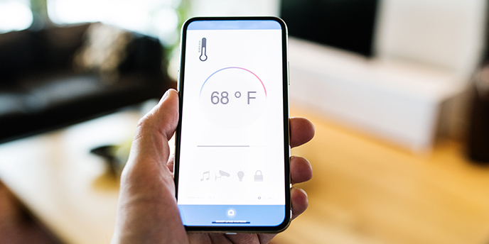Phone With Smart Thermostat App.