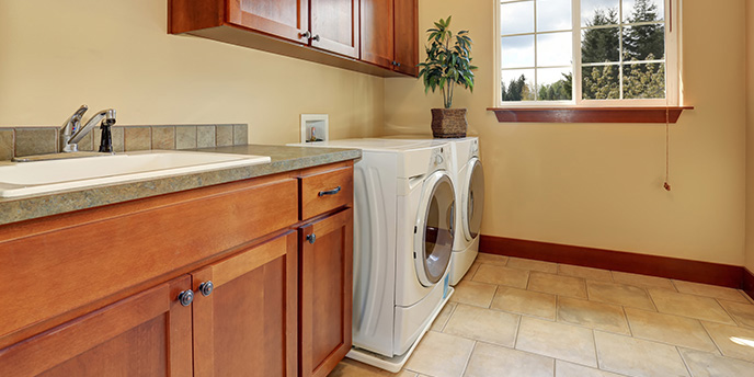 Tidy Laundry Room with Washer and Dryer.