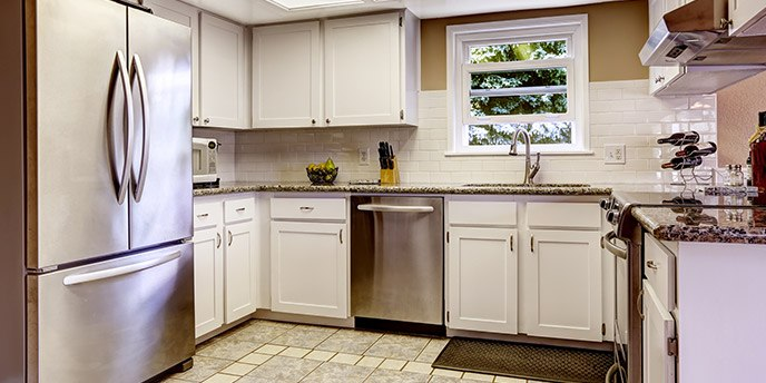 Modern Kitchen with Stainless Steel Refrigerator.