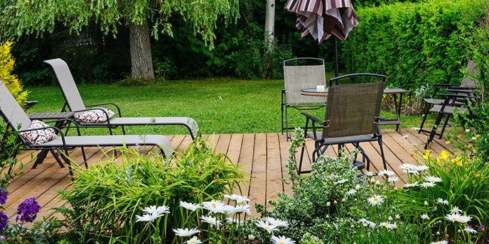 Backyard Wooden Deck With Chairs and Umbrella