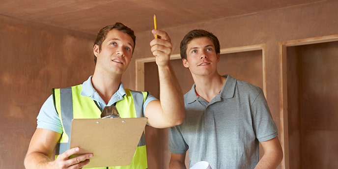 Home Inspector and Homeowner Looking at a Property