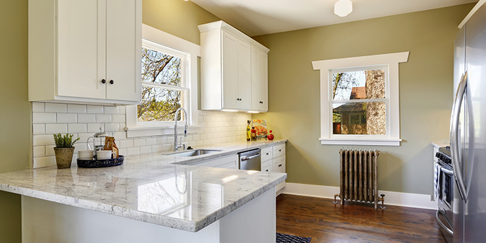 Freshly Updated Small Kitchen With White Cabinets and Subway Tile