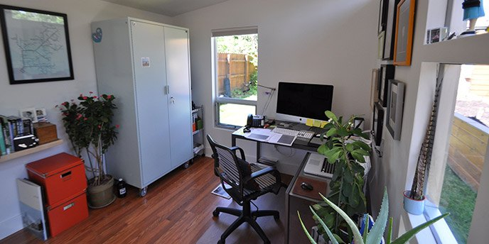 Backyard Shed Converted to a Home Office With Desk, Chair and Filing Cabinet