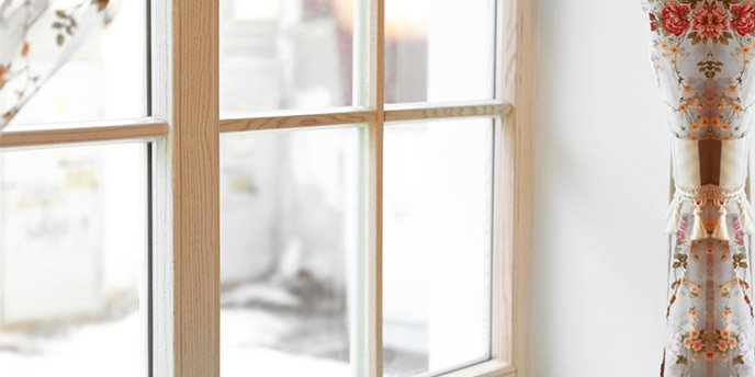 Large Wooden Window with Floral Curtains