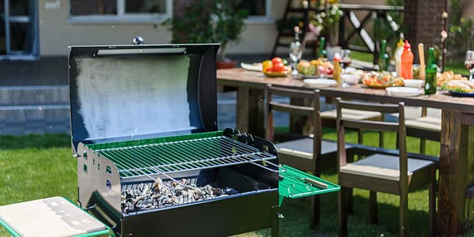 Backyard Grill With Table Set for BBQ