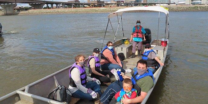 Masked Volunteers Gather on Boat