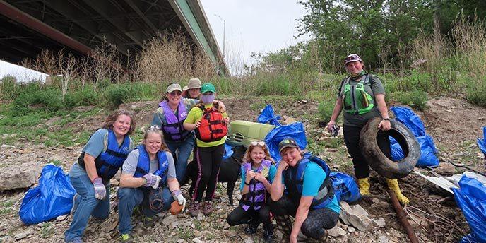 Volunteers Pose With Trash Bags