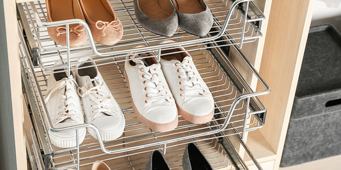 Shoes on Shelves of Organized Walk-In Closet