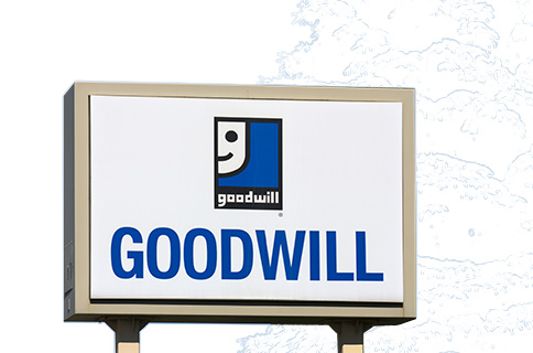 Goodwill Logo on Sign With Blueprint Background