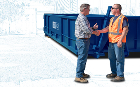 Two men shaking hands in front of a blue roll off dumpster.