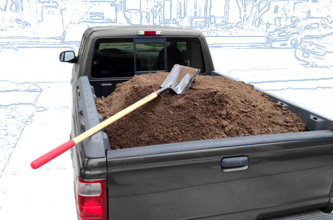 Pickup Truck Bed Filled With Dirt and Shovel