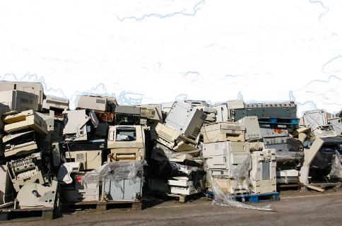Piles of Old Electronics at Hazardous Waste Facility