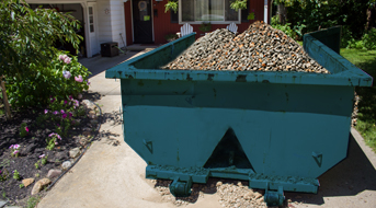 Roll Off Dumpster for Rock Disposal in Driveway