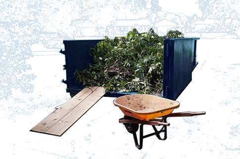 Wheelbarrow Next to Roll Off Dumpster Filled With Yard Waste